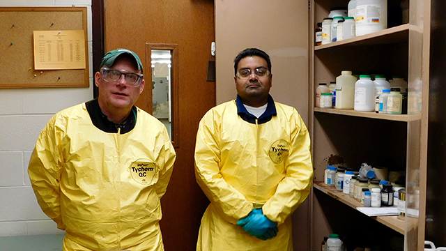Jim Williams (left) and Hemang Rana of Clean Harbors at Chute Middle School in Evanston. Clean Harbors partnered with Northwestern's Office for Research Safety safely dispose of excess chemical products from six local schools Dec. 28-29