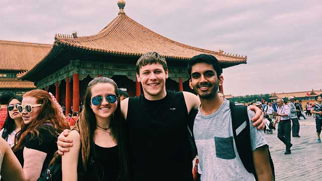 From the left, Cassie Helfer, Ross Kaufhold and Abhinav Talwar visit the Forbidden City as part of the 2017 Public Health in China program.