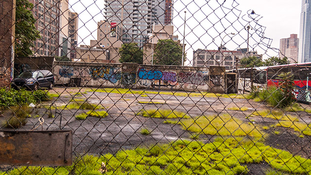 fenced urban lot with graffiti