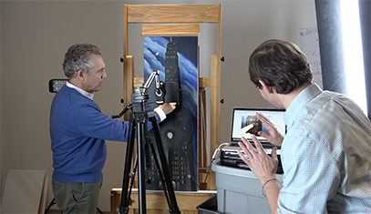 Researchers with painting and camera